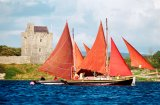 Galway Hookers taking part in Crinniu na mBad, Kinvara, Co. Galway with Dunguire Castle as a backdrop.