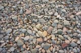 """Face in the Crowd"" amongst pebbles on Salthill Beach."