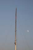 Climbing the mast with a rising moon as a backdrop.